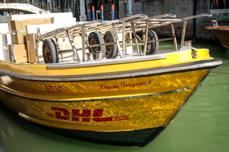 Venice Walking Tour: A DHL delivery boat in Venice