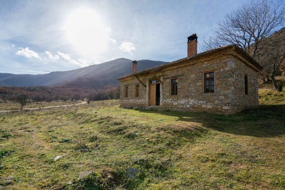 7 Airbnb tips for first time users: A stone home in a remote park in Greece