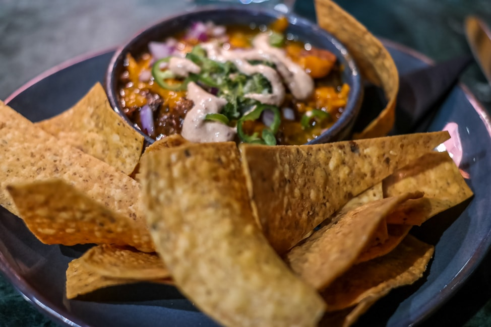 unique London restaurants: a snack of nachos at Temper in London's SoHo
