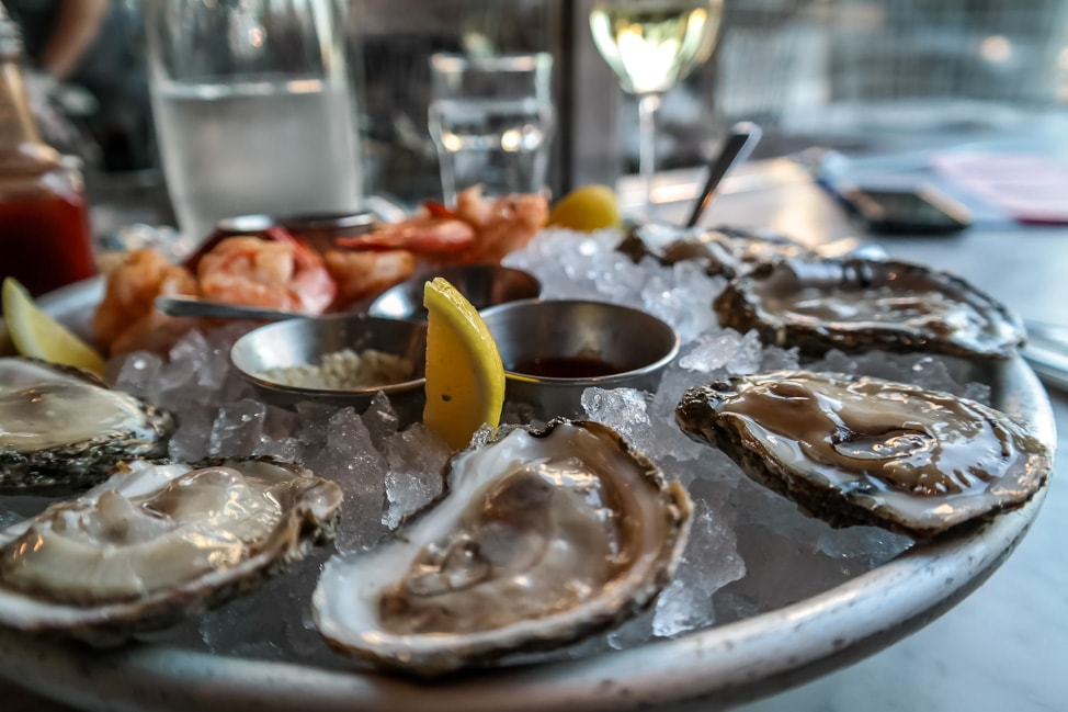 best things to do in charleston: oysters at The Darlings happy hour