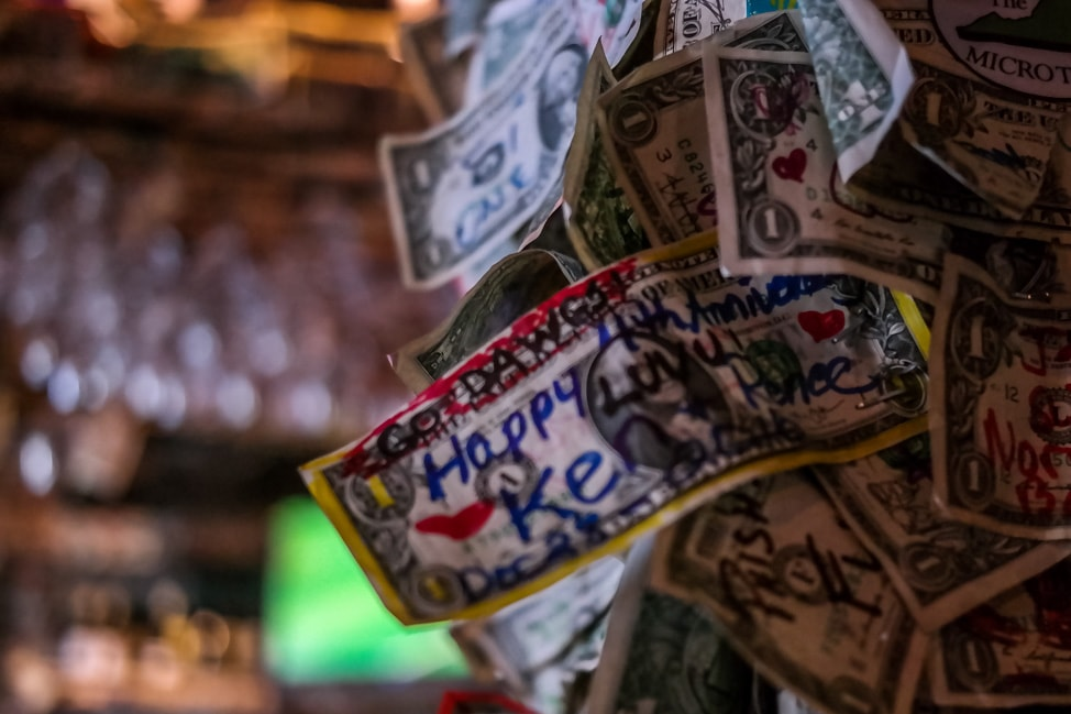 best things to do in charleston: the dollar bills on the wall at the Griffon