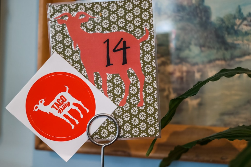 The best West Asheville breakfast: the quirky billy goat logo from Taco Billy